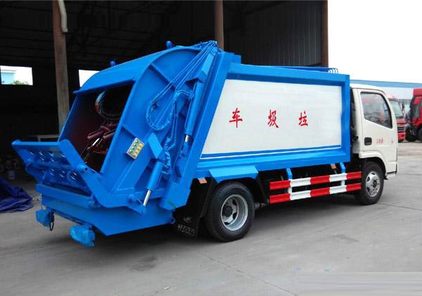 欧曼12方压缩式垃圾车多方位图片二